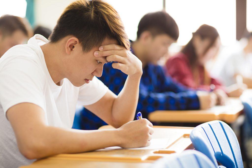 Boy Sitting Exam