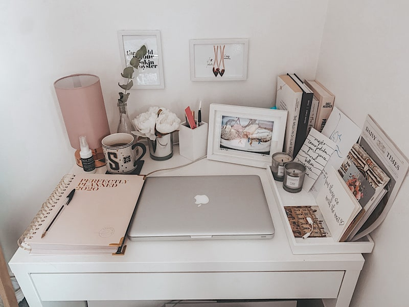 Desk with laptop and photos