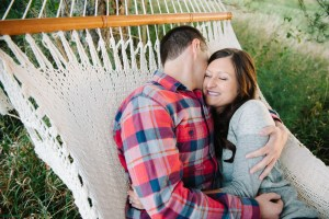 Snuggling in a hammock during engagement session in Omaha, Nebraska.