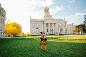 Old Capitol Building in Iowa City engagement Hawkeye football touchdown.
