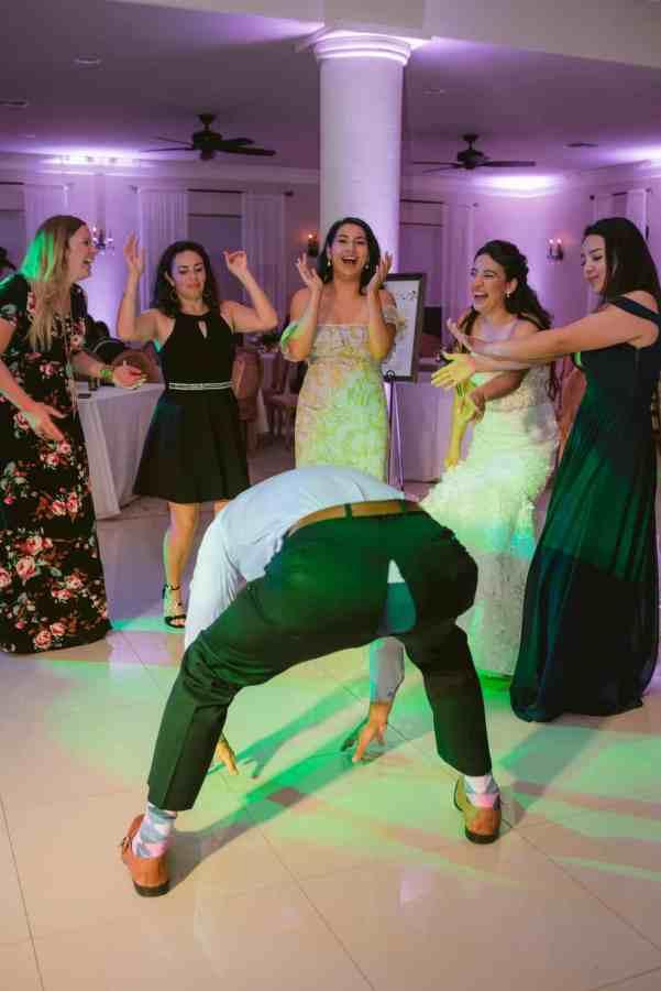 Guy break dances at Thistlewood manor & gardens wedding