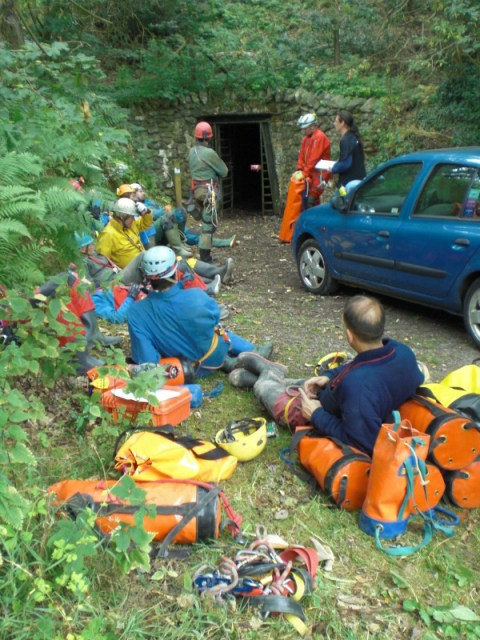 The rescue parties waiting to enter the mine. Note the important man with the clipboard!