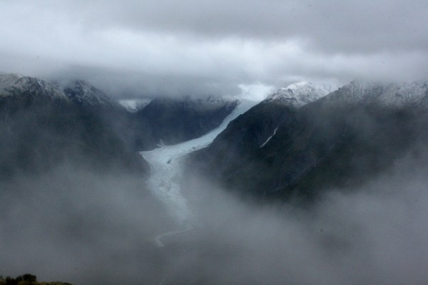 First glimpse of the glacier through the cloud.