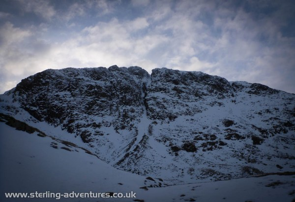 A moody picture, at the end of the long approach path, of Great End in it's early season winter garb.
