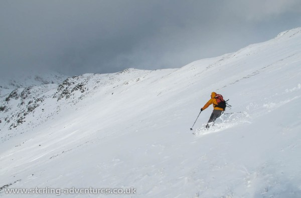 Pete gets a nice turn in on the higher level powder snow.