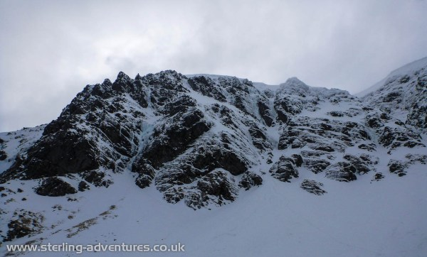 The upper Coire Ardair of Creag Meagaidh, the line of the Pumpkin is the major iced corner to the left.
