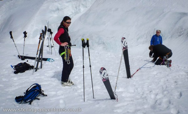 Laetitia, Chris, and Ian in a forest of skis and poles practicing crevasse rescue in the Valleé Blanche
