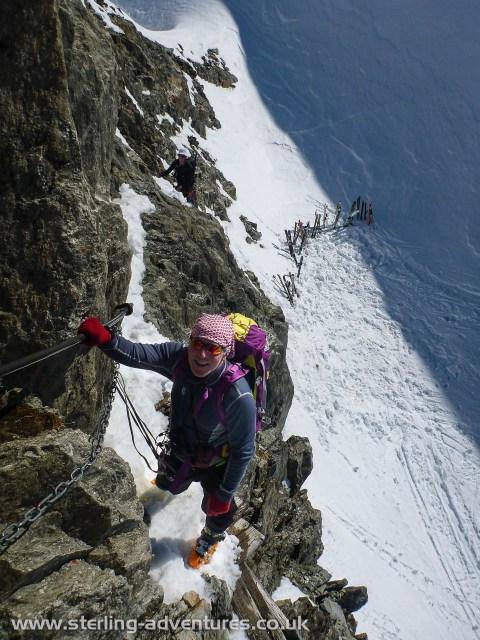 Ian climbing the rocks towards the Grand Mulets hut
