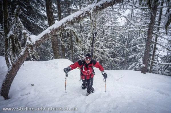 Chris hiking through the deep snow back up to the track between the Retour Pendant and Plan Roujon chair lifts