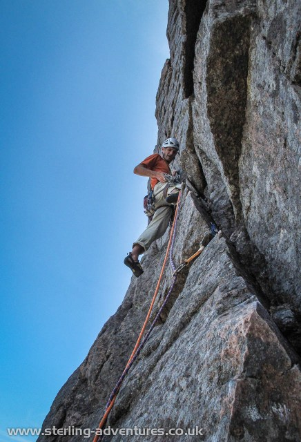 Pete climbing the technical crux pitch of the route.