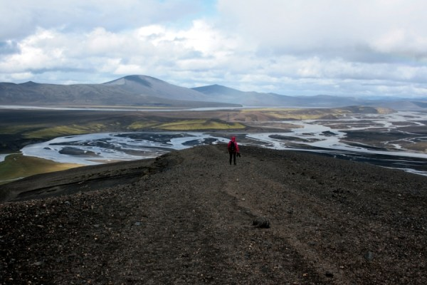 Rachel on the crater rim in front of the braided river.