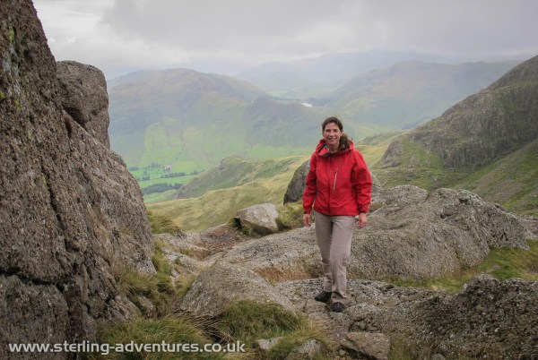 Laetitia at the top of Jack's Rake where we quickly donned our water proof clothing!