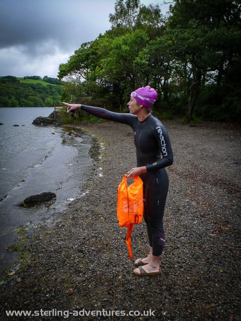 "Laetitia pointing out in to Consiton Water, ""we should swim to there!.  As if it's possible to point at some arbitrary spot of a completely scary and featureless body of water!"