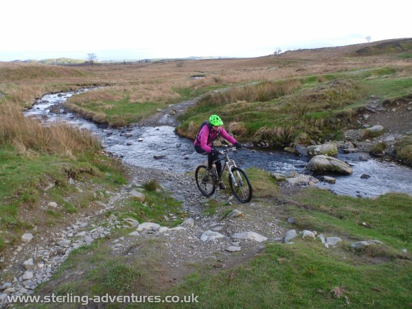 Laetitia successfully crosses the ford above Kentmere