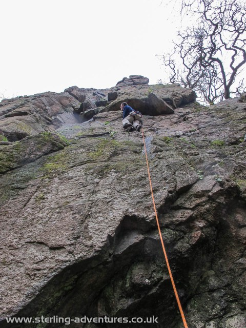 Pete eyes up the doubtful flakes on the first pitch of Climbers' Club Ordinary route at the Dewerstone