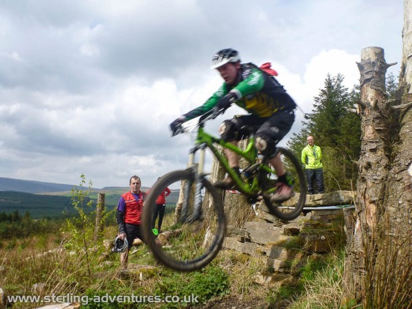 A rider flying off a drop in the organised time-trial at Gisburn Forest