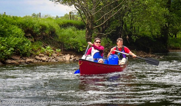 Laetitia and Pete paddling down the river Balvaig between Lochs Voil and Lubnaig