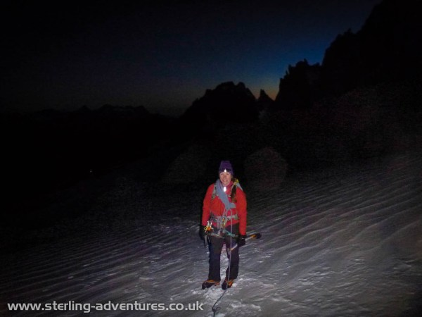 Laetitia on the approach slopes of the Aiguille du Chardonnet as dawn starts to appear behind the mountains