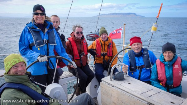 Steve, Cathy, Sam, Coel, John, David, and Clare onboard the Countess of Sleat with Eigg behind