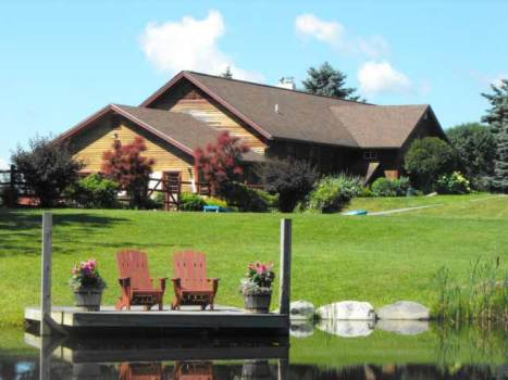 Mansfield House with pond | Sterling Ridge Log Cabin Resort