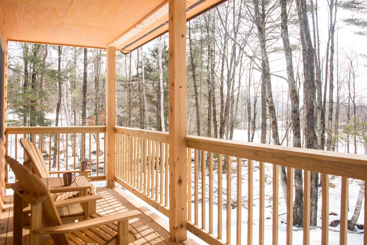 View from a covered porch at a cabin during winter | Sterling Ridge Resort