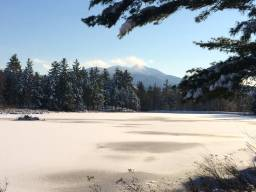 mount mansfield as seen from pond house late fall at sterling ridge log cabin resort