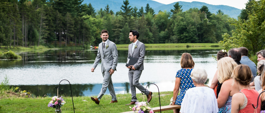 weddings in vermont - two men in front of pond