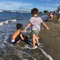 boys playing in the surf