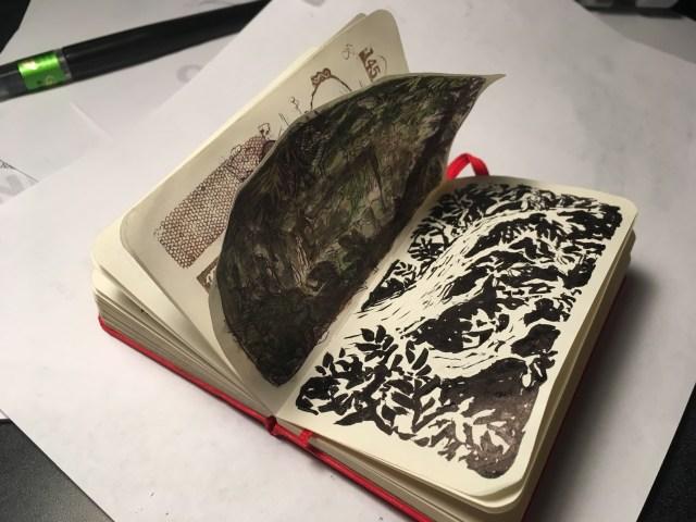 Red open sketchbook