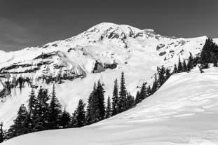A black and white landscape photograph of Mount Rainier during Winter near the Paradise Visitors Center at Mount Rainier National Park, Washington.