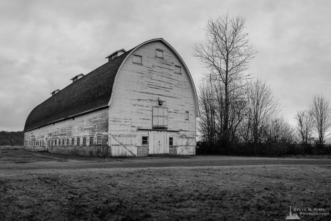A Black And White Photograph Of Historic Barn At The Nisqually National Wildlife Refuge In