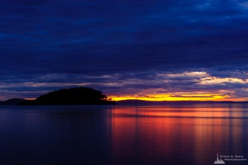 A long exposure landscape photograph of the July sunset along North Beach at Deception Pass State Park, Washington.