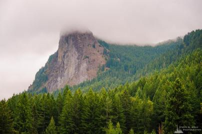 A landscape photograph of the West face of Tower Rock in the Gifford Pinchot National Forest near Cispus Center, Washington.