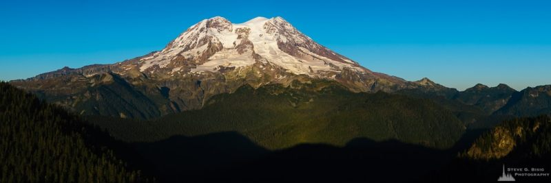 A panoramic landscape photograph of Mount Rainier as viewed from the Glacier View Lookout near Ashford, Washington.