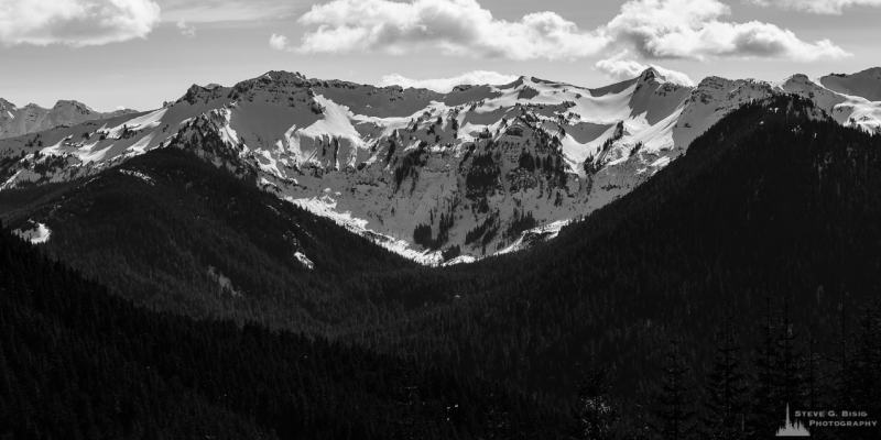 A black and white panoramic photograph of the Clear Fork Cowlitz River valley and the surrounding snow covered Coyote Ridge in the Goat Rocks Wilderness Area as viewed from Gifford Pinchot National Forest Road 1284 in Lewis County, Washington.