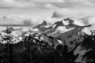 A black and white landscape photograph of Old Snowy Mountain and surrounding mountain peaks in the Goat Rocks Wilderness Area as viewed from Gifford Pinchot National Forest Road 1284 in Lewis County, Washington.