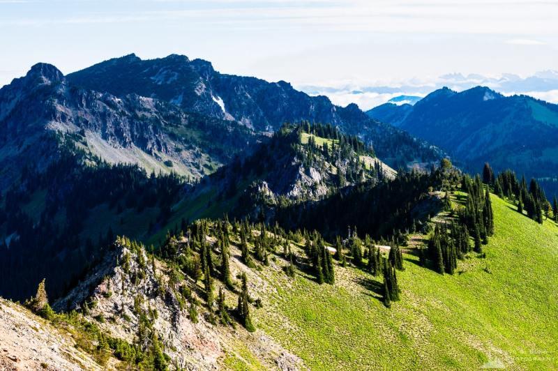 A landscape photograph of the Sourdough Mountains as viewed from the Dege Peak trail near Sunrise, Mount Rainier National Park, Washington.