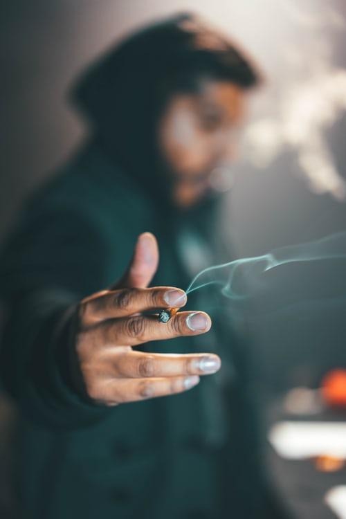 A man holding a cigerette