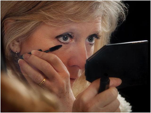 Actress Putting On Eye Make Up