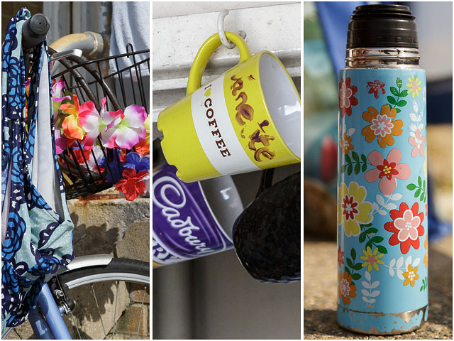 Coffee Cup On Hook With Flowered Thermos Flask And Flowers In Bicycle Basket