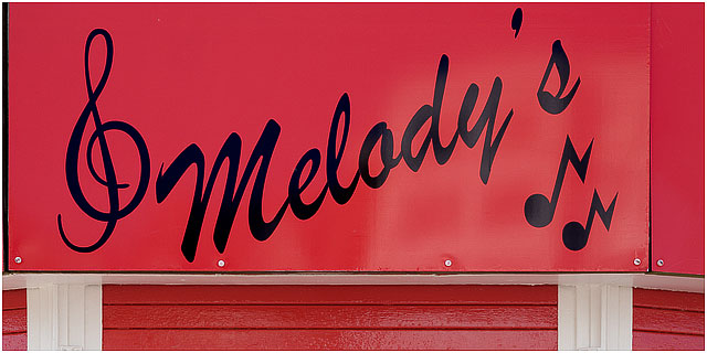 Melodys Red Ice Cream Kiosk Sign