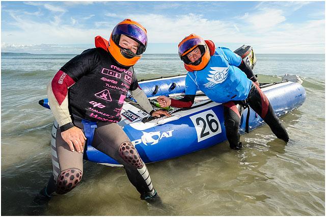 Portrait Of Portsmouth Zapcat Race Team On Shoreline With Boat