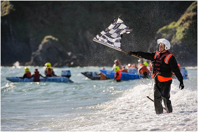 Race Official Waving Flat On Shoreline At Zapcat P750 World Championships
