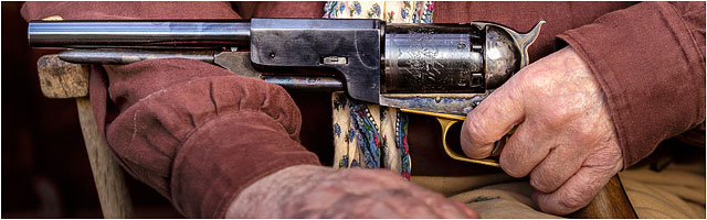 Close Up Of 1847 Colts Dragoon Revolver Held By Wild West Reenactment Player
