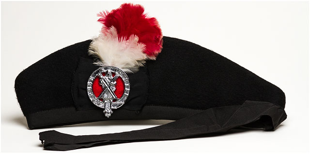 Glengarry Bonnet With Rose And Thistle Brass Band Badge On White Background