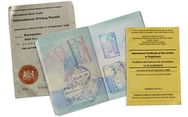 Stamped British Passport International Driving Permit And Vaccination Certificate