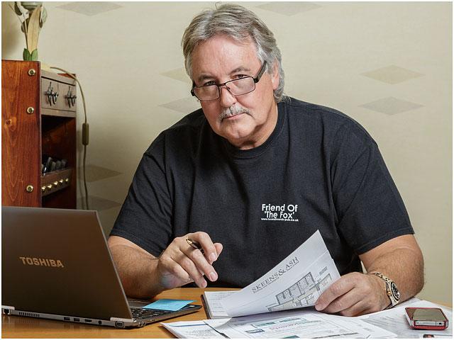 Laptop Man Black T-shirt Glasses Paperwork Office
