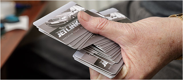 Hand holding fanned out credit cards