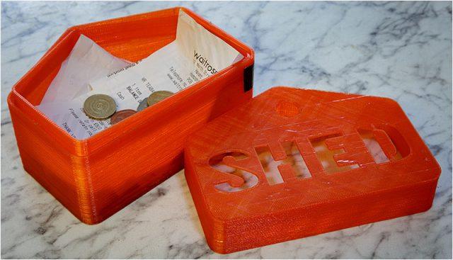 Red Havant Men's Shed plastic money box