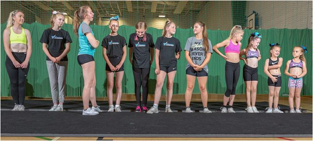 range of ages for the girls in the warriors cheerleading squad